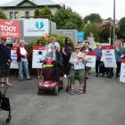 Protesters outside Healthcare NZ's Oamaru office in Coquet St yesterday, demonstrate against a...