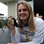 Oamaru's Isobel Ryan shows off her 100m backstroke Mountain West conference swimming gold medal...