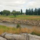 Last week's floods in Southland have exposed an old landfill in Gore. Photo: Gore District Council