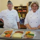 St Kevin's College kitchen site manager Laney Millar and chef Bruce Millar with some of the meals...