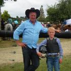 George McFadzien (pictured with father Cameron) has started competing in the novice steer-riding...