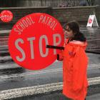 Crossing patrol volunteer Iris, a senior pupil at North East Valley Normal School, with the new...