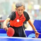 Gerard Lucas is all motion in a table tennis match at the masters games at the Edgar Centre...