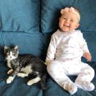 Taz, formerly Brighton, with his youngest human sister, Ella Rose. Photo: Supplied