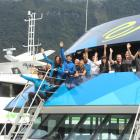 On board...Real Journeys Milford Sound cruise crew got together to celebrate the road being one...