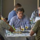 Wanaka's Michael Seiler (centre) tries his hand at judging beer at the New Zealand Beer and ...