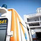 Ambulances carry patients on to the docked passenger ship 'Splendid', which has been transformed...