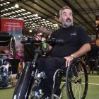 Melrose sales manager Chris Hanley shows off a wheelchair power add-on   at the Show Your Ability...