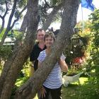 Alan and Carolyn Eagle in their Dunedin garden, which is dominated by a massive southern rata.