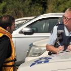 Senior Constable Murray Hewitson, of Owaka, speaks to a man, whose first name was Anthony, who...