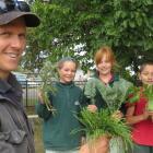 Hinds School pupils Kezia Fox (holding Scottish Thistle), Matisse Eccelstone (kale) and Fabian...