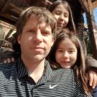 Former Otago man Brendon Gately, now living in South Korea, with his daughters Joanne (back, 9)...