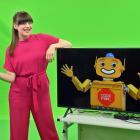 Dunedin television presenter Rosalind Manowitz, with an image showing her robot sidekick Digi, in...
