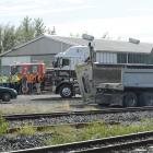Emergency services arrive at the site of a collision between a train and truck near the...