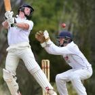 Green Island opener Geordie Scott looks to guide the ball past North East Valley wicketkeeper...