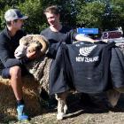 New Zealand junior curling team members Anton Hood (left) and Ben Smith meet the supreme champion...