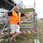 Warbirds general manager Ed Taylor in front of the grandstand being taken apart yesterday. PHOTO:...