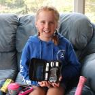 Alice Henderson (10) with some of the equipment she uses to manage her Type 1 diabetes. Photo:...