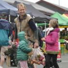 Andrew McCurdy with daughters Isi (5) and Dara (9) shop at the Otago Farmers Market on Saturday....
