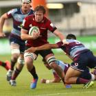 The Crusaders' Cullen Grace makes a break against the Reds. Photo: Getty