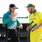 Captains Kane Williamson (left) and Aaron Finch react after accidentally shaking hands prior to...