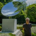 Artist Anish Kapoor stands in front of his work Sky Mirror in Porto, Portugal. Photo: Getty Images
