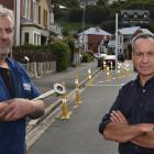 Local businessmen Mike McMillan (left) and Jim Strang are deeply unhappy about changes to parking...
