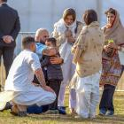 Huata Arahanga hugs five-year-old Ayaan Naeem, who lost his father and brother in the massacre on...