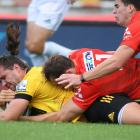 Kobus Van Wyk of the Hurricanes scores a try during the round five Super Rugby match between the...