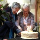 Pat, Lady Mark and Olive, Lady Hutchins cut the cake at the 50th anniversary celebrations of the...
