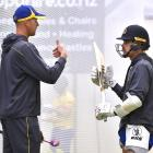 Anton Roux (left) speaks with Volts allrounder Michael Rippon. Photo: Getty Images