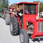 Mental health advocate Mike King sits in a Massey Ferguson 35, leading a line-up of tractors in...