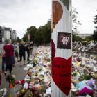 People pay their respects in Christchurch following last year's terrorist attack on two mosques....