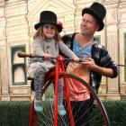 Eddie Robinson, of Oamaru, and daughter Piper (3) try out the penny-farthing carousel at...