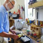 Retired zoologist and Lake Wanaka marina grebes project founder John Darby with the eggs that did...
