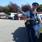Sergeant Blair Wilkinson, of Oamaru, at Awamoa Park in Oamaru where vehicles parked up for sale...