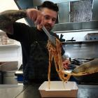 Pablo Tacchini, owner of Cucina in Oamaru, dishes up a takeaway meal yesterday. PHOTO: DANIEL...