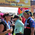 Alps 2 Ocean Ultra competitors enjoy a well-earned drink after crossing the finish line at Oamaru...