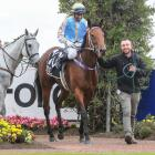 Trainer Robert Dennis leads Out Of The Park and Krishna Mudhoo back to the winner's enclosure at...