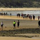 Runners snake along the beach section of the 15km Papatowai Challnege on Saturday. PHOTO: STEPHEN...