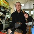 Paul Ayers repairs footwear in his Stuart St premises before making home deliveries to customers....
