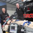 Demonstrating the Queenstown helicopter rescue service's new automatic CPR machine on a mannequin...