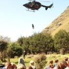 Paramedics from the Queenstown Helicopter Rescue service give a winching ...