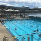 Swimmers take refuge from the abnormally warm Dunedin weather at the St Clair Hot Salt Water Pool...