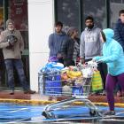 Customers queue outside Countdown central Dunedin last week prior to the lockdown. PHOTO: STEPHEN...