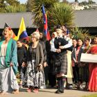 Representatives of many cultures, including from South Korea and China, walk on to the Arai Te...