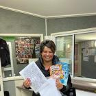 Brockville School principal Tania McDonald holds one of the education packs that staff have been...