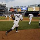 The New York Yankees take the field before their MLB Interleague game against the Arizona...