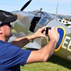 Ray van der Vliet, of Mosgiel, photographs a replica British Supermarine Spitfire MK 26 at the...