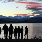Young people gather on the Lake Wanaka foreshore. Photo: Stephen Jaquiery